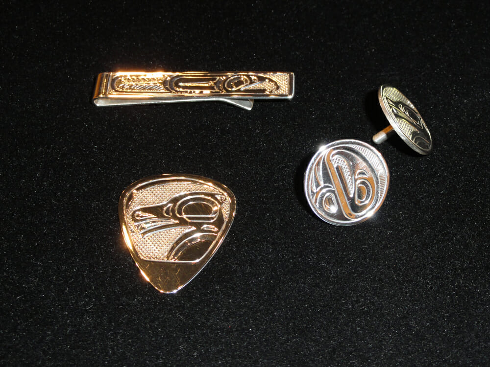 Tie bar, guitar pick & golf ball makers